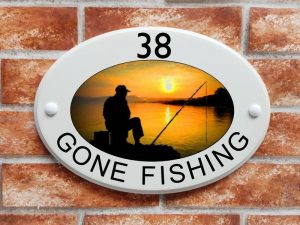 Angler fishing house sign