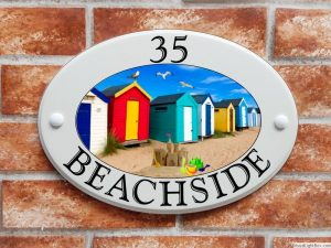 Beach huts seaside house sign