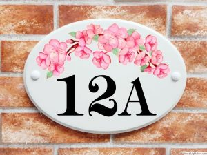 Cherry blossom flowers house number sign