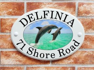 Leaping dolphins house sign