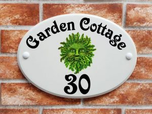 Green man design house sign