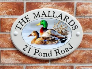 Mallard ducks house sign