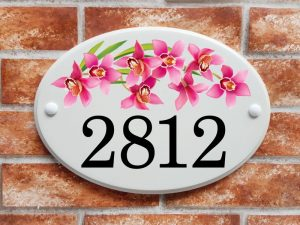 Orchid flowers house number sign with 4 digits