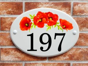 Poppy flowers house number sign