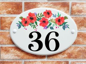 Red flowers house number plaque