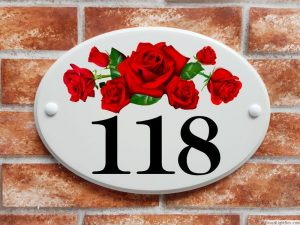 Red roses flowers house number sign