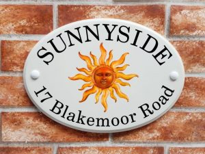 Sun symbol house plaque